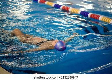 Beautiful pregnant woman happy smiling in swimming pool