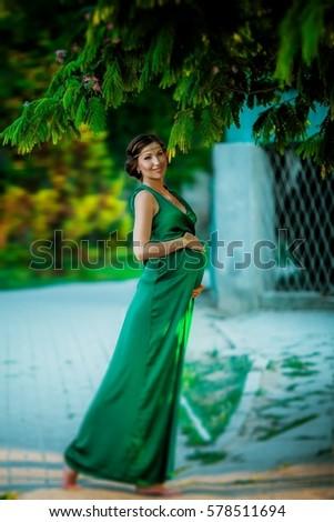 46dfe96ade4 Beautiful Pregnant Woman Long Green Dress Stock Photo (Edit Now ...
