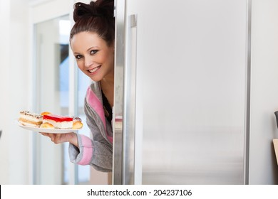 Beautiful pregnant woman looking for food