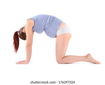 Beautiful pregnant woman making yoga