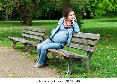 Beautiful pregnant woman in the park