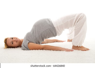 Beautiful pregnant woman smiling and doing exercises on the floor - isolated