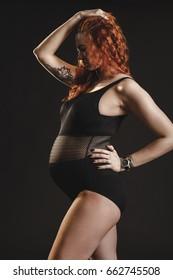 Beautiful pregnant woman in studio.