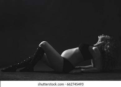 Beautiful pregnant woman in studio.  Black and white photo