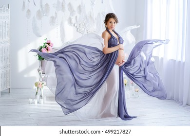 beautiful pregnant woman in violet dress luxury at the tender interior,Charming pregnant woman in flying elegant dress