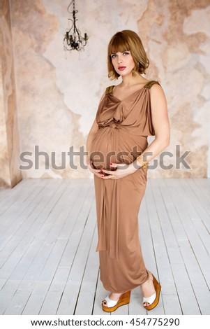 a338918dabd94 Beautiful Pregnant Woman Wearing Elegant Brown Stock Photo (Edit Now ...