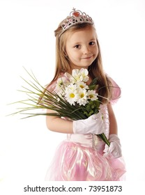 A beautiful preschool princess holding a bouquet of white flowers.  Isolated on white.