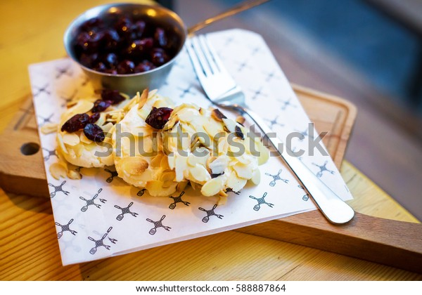 Beautiful presentation Syrnikov sausages with cherry and almond flakes