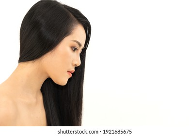 Beautiful pretty asian woman clean fresh healthy white skin beauty health care with black long shiny straight smooth hair isolated on white background.Hair cosmetics