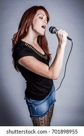 Beautiful pretty redhead singing woman