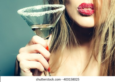 Beautiful woman? pretty sexy lady holding glass of tasty alcohol martini in her hand