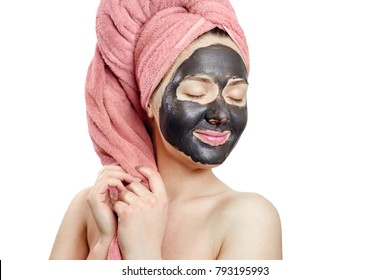 beautiful pretty sexy woman with black face mask on white background,  close-up portrait, isolated, pink towel on head, girl is smiling, enjoys emotional gender role