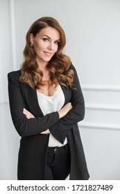 beautiful pretty woman business portrait in black suit with white shirt