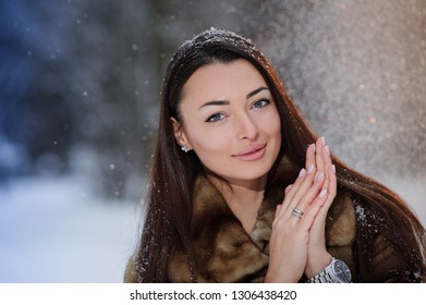 Beautiful pretty young woman in winter forest.