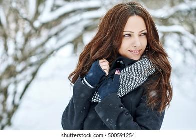 Beautiful pretty young woman in winter