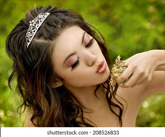 Beautiful princess about to kiss her frog prince