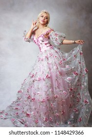Beautiful princess in pink gown dress with lace and roses