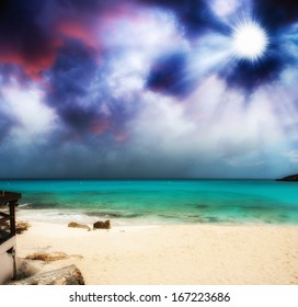 Beautiful pristine beach with colourful sky at sunset.