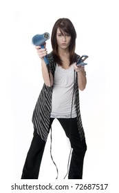 Beautiful professional hair stylist holding blow dryer and straightener