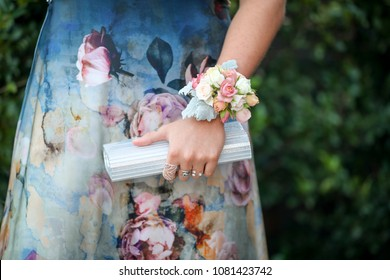 Beautiful prom girl and her corsage.