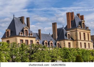 Beautiful Public Park near Palace of Fontainebleau (Chateau de Fontainebleau, 1137) - one of largest French royal chateaux in suburban of Paris (55 kilometres). Fontainebleau, France.