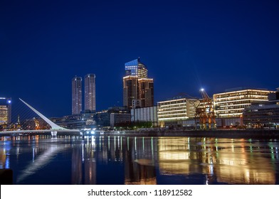 Beautiful Puerto Madero and the Women's Bridge at night