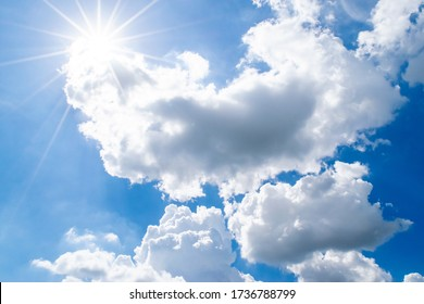 Beautiful Puffy Clouds and Bright Sun in Sky (Background: Sun Rays and White Clouds)