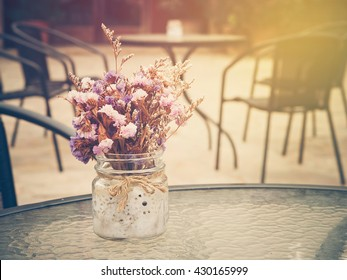 Beautiful purple flowers bunch on table glass with sunlight and summer season. : Photo in vintage style.