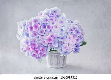 Beautiful purple hydrangea flowers close-up in a vase . The image was specially created by using a texture overlay.