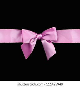 Beautiful Purple / Pink ribbon gift bow isolated on black background