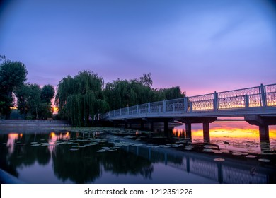 beautiful purple sunset over a lovely footbridge and little island