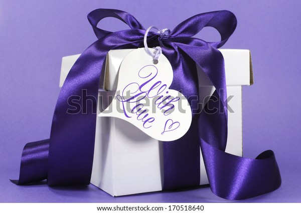 Beautiful purple and white gift with luxury ribbon and love heart for Christmas, Easter, Valentine, Mothers Day or birthday occasion.