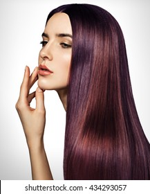 Beautiful purple woman with long, healthy, straight and shiny hair. Hairstyle loose hair. Model girl with luxurious smooth straight hair. Hair cosmetics. White background.