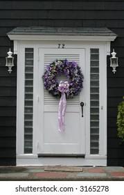 beautiful purple wreath on white door
