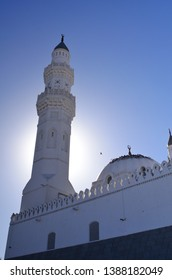 The Beautiful Quba Mosque with majestic sky and sun flare behind the tower