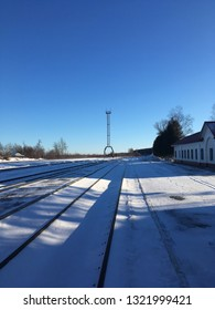 Beautiful railway station winter with ultramarine shadows. Landscape - architecture. Russian trip. Russia and Europe. Winter architecture. Beautiful metal tower. Tula — travel. Snow railway road.