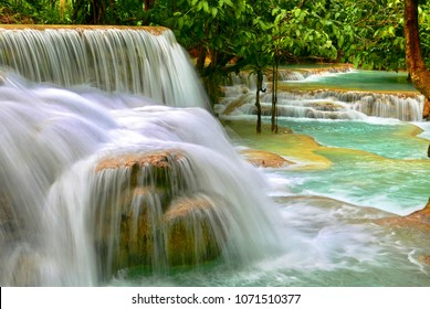 Beautiful rain forest landscape with one of southeast Asia's most beautiful waterfalls, the Kuang Si falls with cascading turquoise swimming pools.