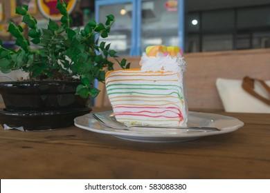 Beautiful rainbow crepe cake in coffee shop.