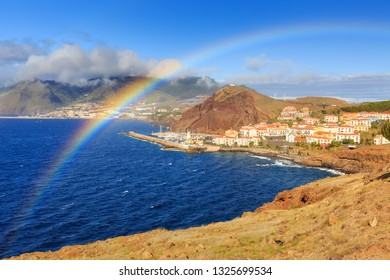 Beautiful rainbow landscape view of the coastline on the east coast of Madeira island, near Canical, with the atlantic ocean in summer