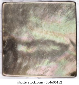 beautiful rare natural pearl black pearl with iridescent tints and inclusions in the form of a square plate for mosaic