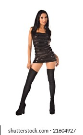Beautiful raven haired club girl in a black mini dress and thigh high go-go boots