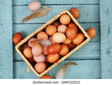 Beautiful raw chicken eggs on a blue wooden background