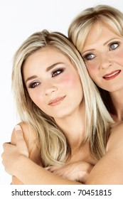 beautiful real couple mother in her 40s and gorwn-up daughter with professional make-up: faces close-up, not isolated