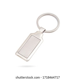 Beautiful rectangle metal keychain with silver key ring and your logo placeholder on metal background. Keychain isolated background. Dome label keychain.