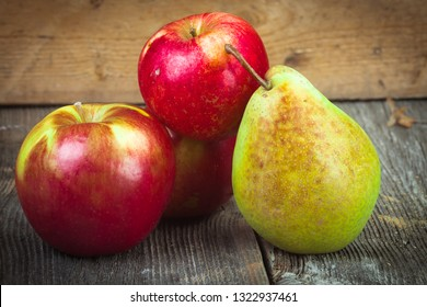 beautiful red apples on a background from wooden boards