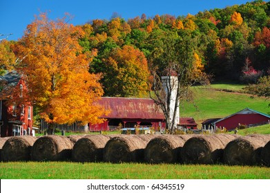 Beautiful red barn and fall colored trees on a gorgeous fall day