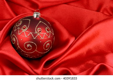 Beautiful red bauble on satin