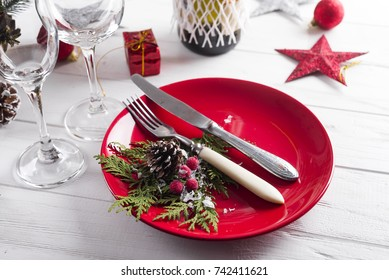 Beautiful red Christmas table setting with decorations on table
