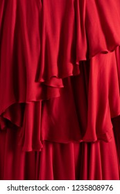 Beautiful red cloth close up. Ruffled layers.