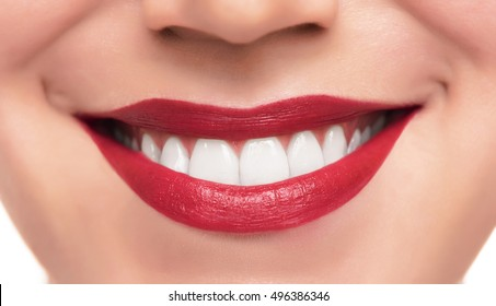 Beautiful red female lips and teeth close up shot.